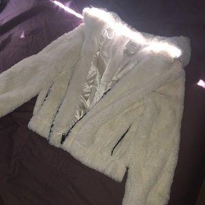 fluffy white zip up